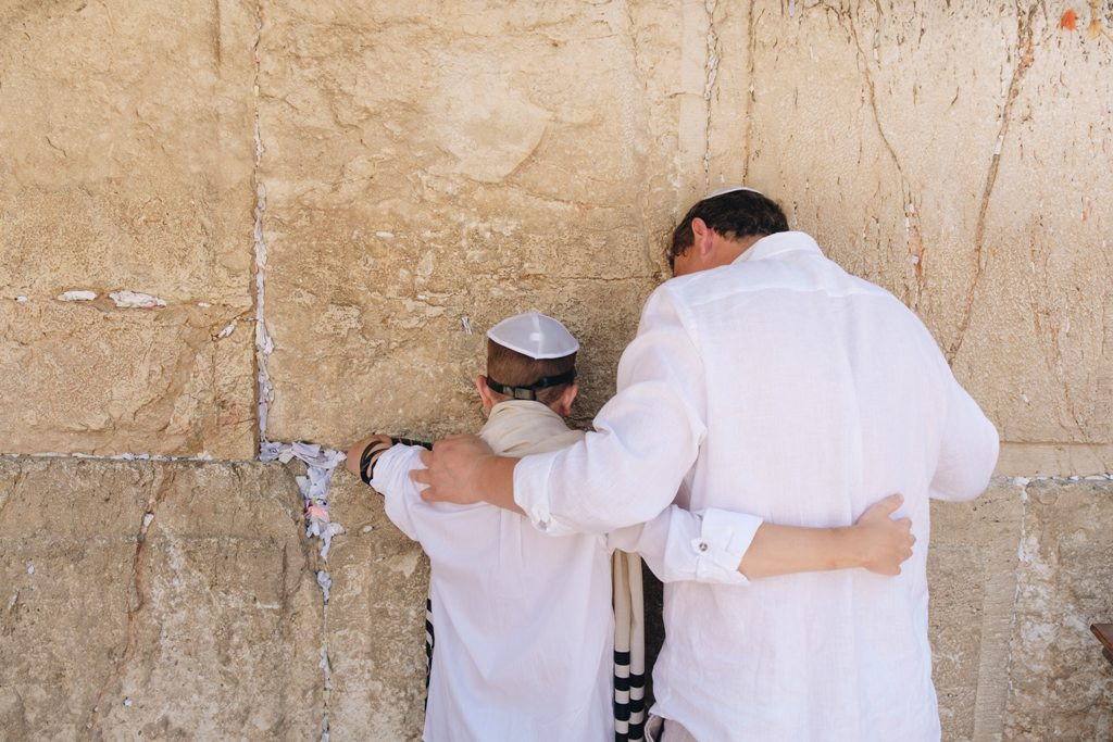 Two men praying in Jerusalem at the Western Wall. (Photo: Anton Mislawsky)
