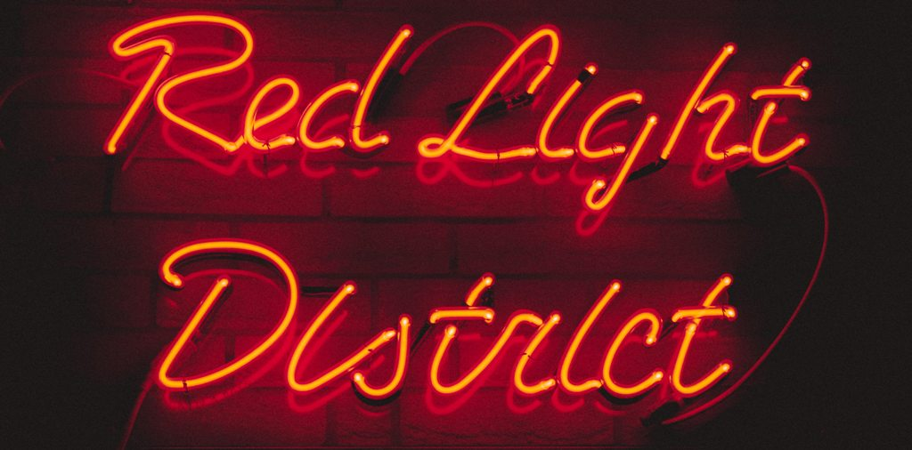 A snapshot from the Red Light District. (Photo: Miltiadis Fragkidis / Unsplash)