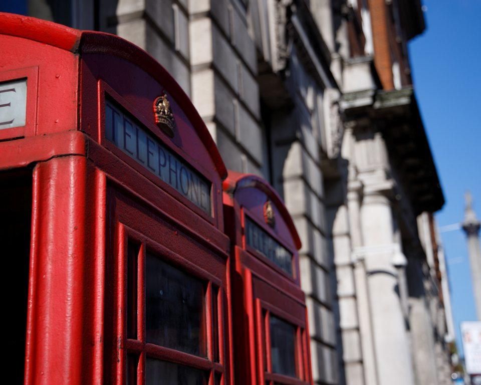 Two telephone boxes on Trafalgar Square, around the corner from ENO. (Photo: Damian Kamp / Unsplash)