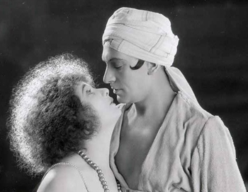 """Publicity still of actor Herbert Langley (right) and Betty Blythe in the film version of the operetta hit """"Chu-Chin-Chow,"""" 1925. (Photo: Ebay)"""