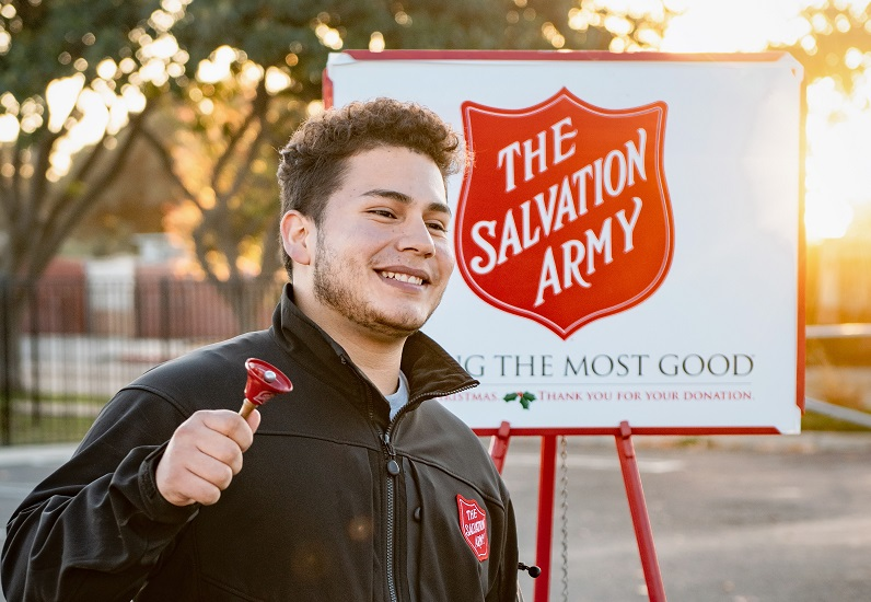 A young man collecting money for the Salvation Army, founded in 1865. (Photo: Tim Mossholder / Unsplash)